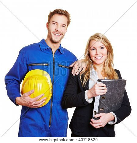 Happy team of worker in overall and business people in a suit