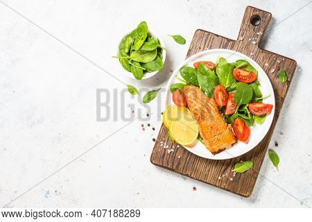 Salmon Fillet With Fresh Salad. Healthy Food, Keto Diet. Healthy Lunch Or Dinner. Top View At White.