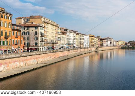Pisa, Italy-october 21, 2018:view Of The Arno River Tha Crosses Pisa During A Sunny Day
