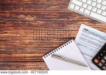 U.s. Individual Income Tax Return, Calculator And A Pen,  Computer Keyboard Tax Form 1040 - Business