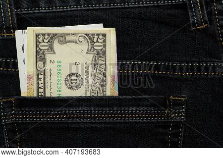 Money In Your Pocket. Dollar Bills In The Back Pocket Of My Jeans. The Concept Of Pocket Money. Cash