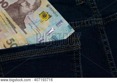 Money In Your Pocket. Ukrainian Hryvnia. 1000, 500, Bills In A Pants Pocket. Jeans Trousers, A Lot O