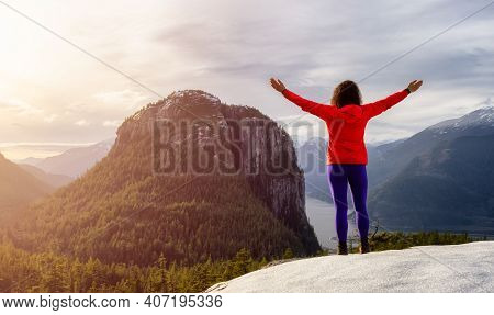 Adventurous Girl Hiking In The Mountains During A Sunny Autumn Sunset. Taken In Squamish, North Of V