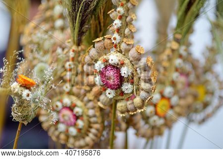 Traditional Lithuanian Easter Palms Known As Verbos Sold On Easter Market In Vilnius. Lithuanian Cap