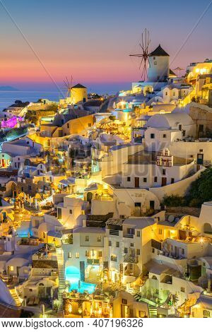 Night after sunset view of traditional Greek village Oia on Santorini island in Greece. Santorini is iconic travel destination in Greece, famous of its sunsets and traditional white architecture
