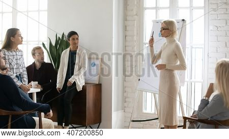 Business Team Leader Presenting Sales Reports At Corporate Meeting