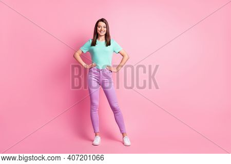 Photo Portrait Full Body View Of Woman With Hands On Waist Isolated On Pastel Pink Colored Backgroun