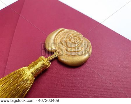 Red Envelope With Golden Wax Stamp And Silk Tassel For Gift Certificate Or Invitation. Close Up Of G