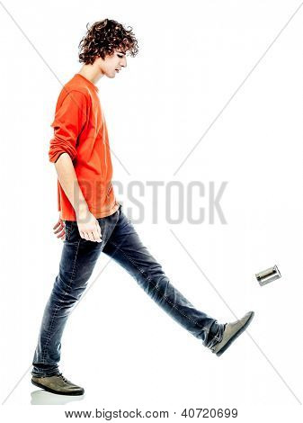 one young man caucasian kicking tin can sad bore side view   in studio white background