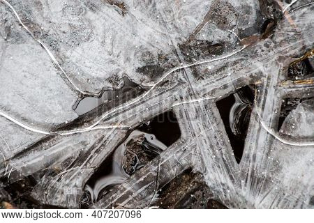 Ice Crust Texture, Formed Ice On The Water Surface, With Light Frost, Winter Or Spring Background