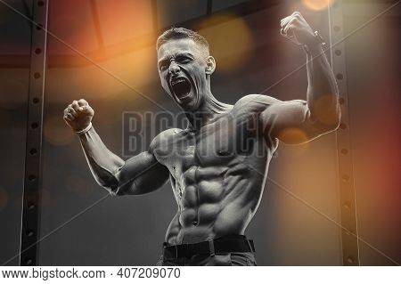 Rage Scream. Energy Caucasian Strong Athlete Screaming In The Gym During Training Abs. Fitness, Body