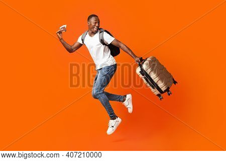 Bye-bye, Im Going Vacation. Young Happy Black Man With Suitcase, Backpack, Passport And Flight Ticke