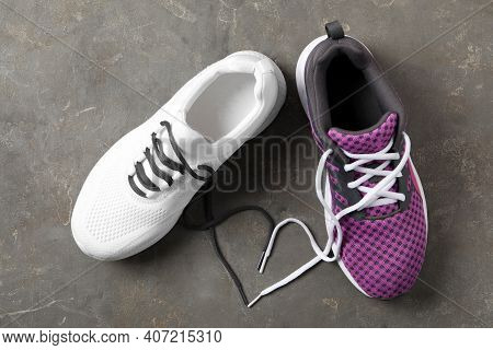 Pair Of Stylish Shoes With Laces On Grey Background, Flat Lay