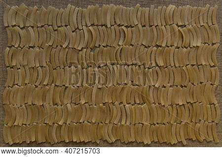 Noodle Background: Finely Chopped Raw Arcuate Noodles Are Laid Out In Rows Tightly To Each Other In