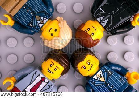 Tambov, Russian Federation - January 17, 2021 Four Lego Businessmen Minifigures On Gray Baseplate Ba