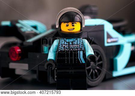 Tambov, Russian Federation - February 19, 2020 Lego Driver Minifigure Against Formula E Panasonic Ja