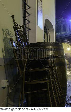 Commercial Premises Chairs Stacked At Night. Borghetto Sul Mincio, Verona, Italy.