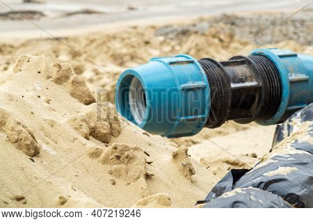 Closeup Of Coupling For Hdpe Pipes On The Sand During The Repair Work Of The Pipeline On The Constru