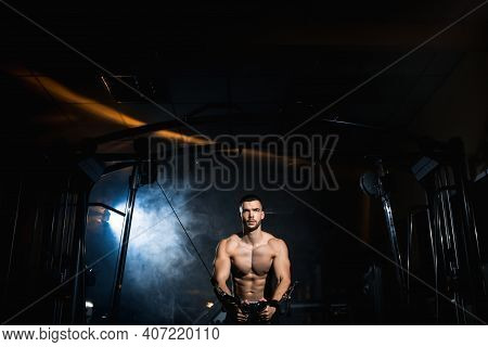 Muscular Fitness Bodybuilder Doing Heavy Weight Exercise In The Gym. Athlete Doing Pectoral Muscle E