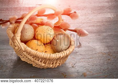Easter Decorations, Toned Image. Wattle Rattan Basket With Two Tone Easter Eggs, Green And Orange. C