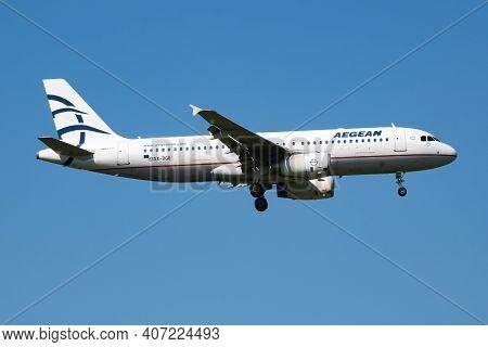Vienna, Austria - May 13, 2018: Aegean Airbus A320 Sx-dgo Passenger Plane Arrival And Landing At Vie