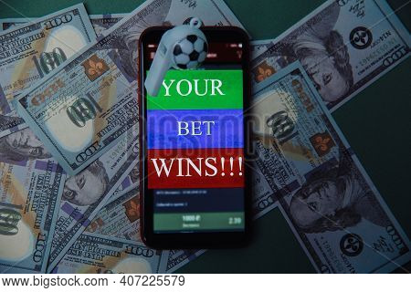 Whistle And Smartphone With Bet Application On Dollar Bills And Green Background. Gambling And Bet C