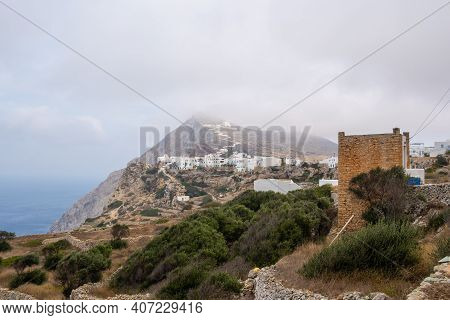 Folegandros Island. View Of The City And The Church On The Top Of The Mountain. Hazy Day. Cyclades,