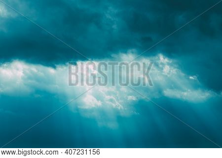 Sunrays Through Blue Rainy Dramatic Sky. Natural Abstract Background.