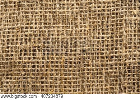 Cloth. The Texture Of The Burlap Fabric Is Close-up. Packaging Material. Background Of Burlap Hessia