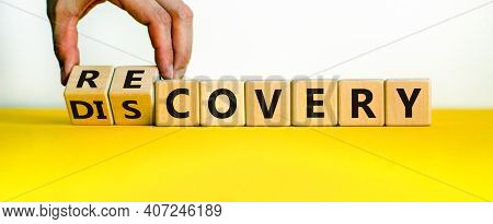 Recovery Or Discovery Symbol. Businessman Turns Wooden Cubes, Changes A Word 'discovery' To 'recover