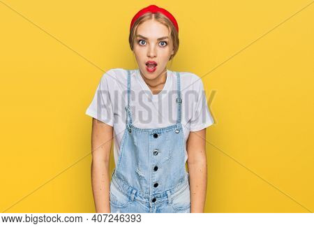 Young caucasian girl wearing casual clothes afraid and shocked with surprise and amazed expression, fear and excited face.