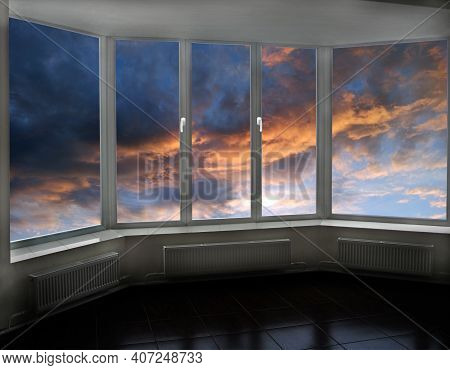 Window With View To Sunset With Dark Cloud. Thunder-storm Clouds Panorama. Evening Coolness. Landsca