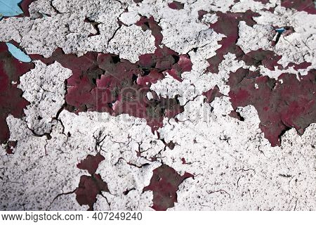 Peeling Paint On The Wall. Concrete Wall With Old Cracked Peeling Paint. Weathered Rough Painted Sur