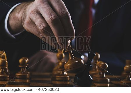 Concept Of Strategy And Business Planning, Businessman Behind A Chessboard White Queen Beats A Black