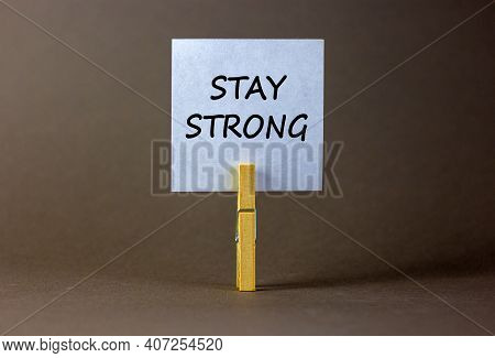 Stay Strong Symbol. Wooden Clothespin With White Sheet Of Paper. Words 'stay Strong'. Beautiful Grey