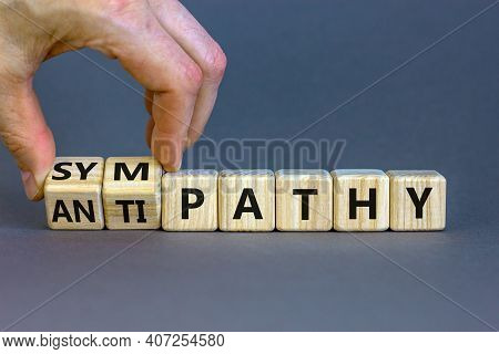 From Antipathy To Sympathy. Businessman Turns Cubes And Changes The Word 'antipathy' To 'sympathy'.