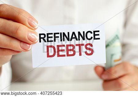 Dollars Bill, White Notepad Sheet On The White Background. Refinance Debts Text. Finance And Economi