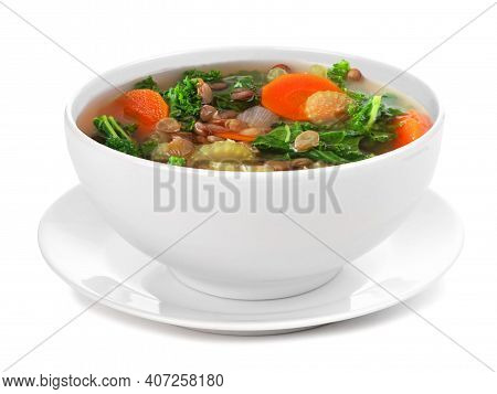 Homemade Kale And Lentil Soup In A White Bowl With Saucer. Side View Isolated On A White Background.