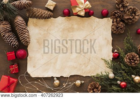 Christmas Composition. Christmas Gift, Knitted Blanket, Pine Cones, Fir Branches Background. Flat La