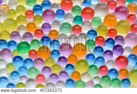 Abstract Multicolored Bright Background With Hydrogel Beads Texture. Water Absorbent Balls