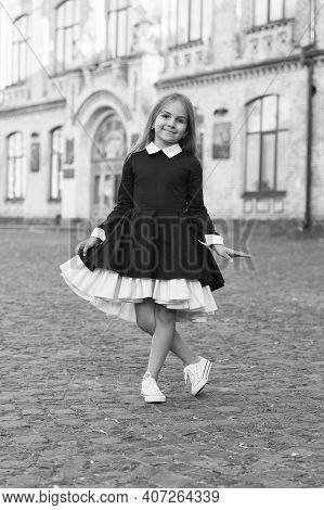 Its Pleasure Of Elegance. Happy Kid Make Curtsy In Uniform Outdoors. Uniform Dress Code. Clothing St