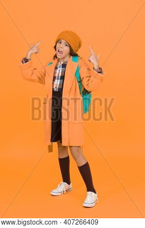 Listen To Me. Unhappy Small Child Hand Gesturing On Yellow Background. Small Schoolchild On Autumn D