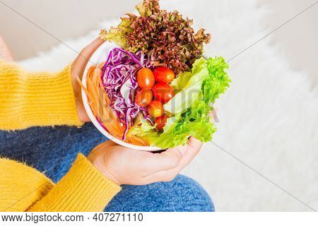 Young Woman Eating Fresh Salad Meal Vegetarian Spinach In A Bowl, Top View Of Female Hands Holding B