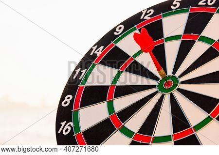 Dart Arrow Hitting To Center On Bullseye (bull's-eye) Dartboard Is The Target Of Purpose Challenge B