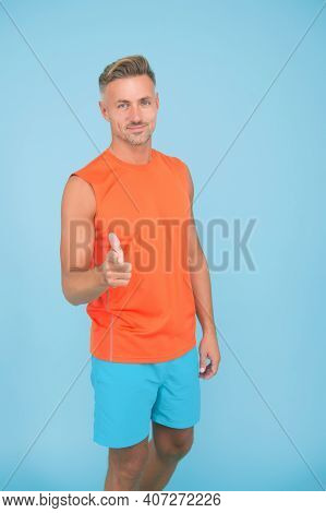 Are You Going To Gym. Sportsman Point Finger Blue Background. Sportsman Physically Fit. Strong Sport