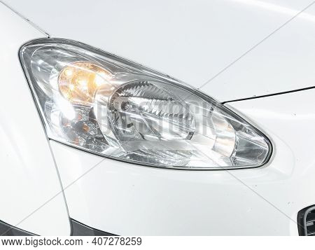 Novosibirsk, Russia - February 07 2021: Peugeot Partner, Headlight Of A Modern Popular Car Close-up.