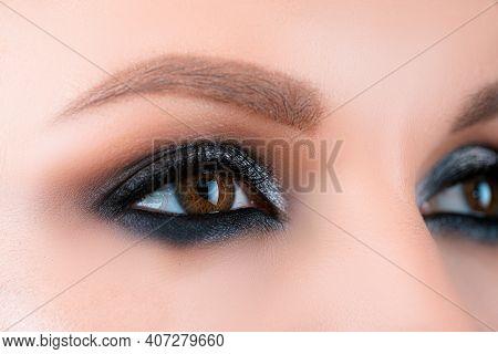 Closeup Smoky Makeup Eye Dark Eyelids. Female Eyes With Beautiful Bright Fashion Style