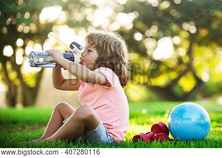 Kid Sport. Boy Drinking Water. Sport Concept. Child Fitness, Health And Energy, Exercises Outdoor