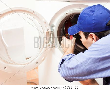 Technician repairing a washing machine