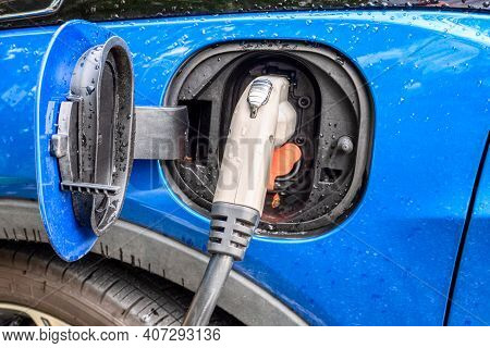 Electric Plug Of Charging Station Connected To A Vehicle For Battery Recharge